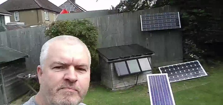 Julian Ilett in garden with solar panels