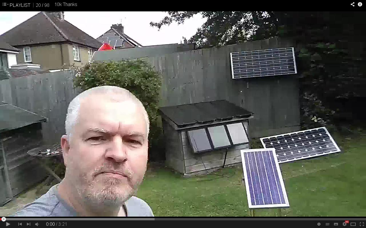 Julian Ilett in garden with solar panels