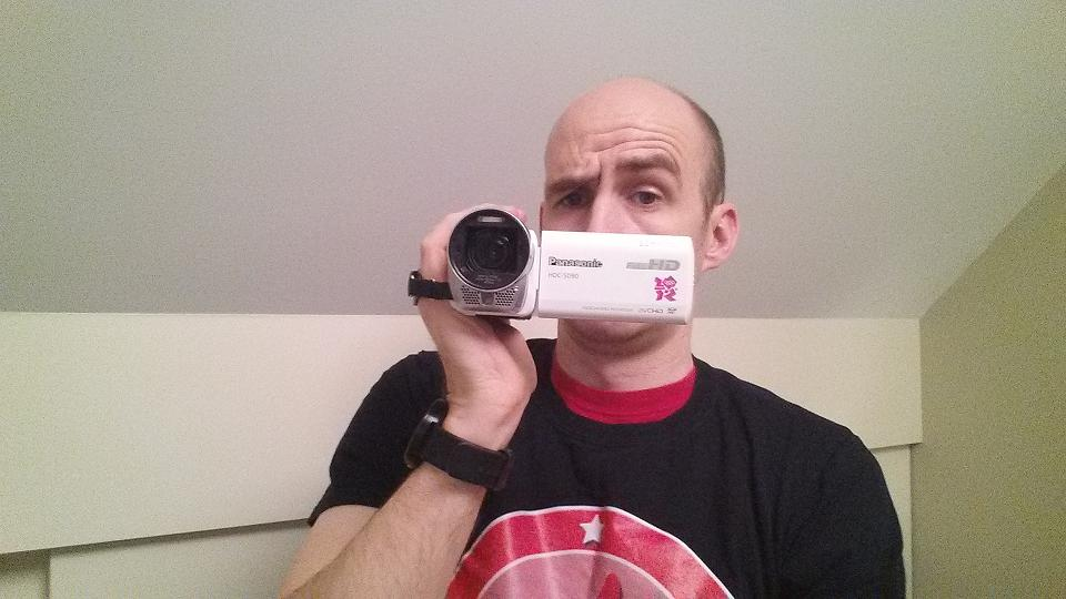 Rob Wilson with camcorder