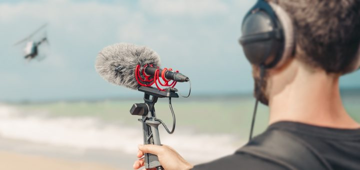 Rode NTG5 microphone being used to record sound on a beach